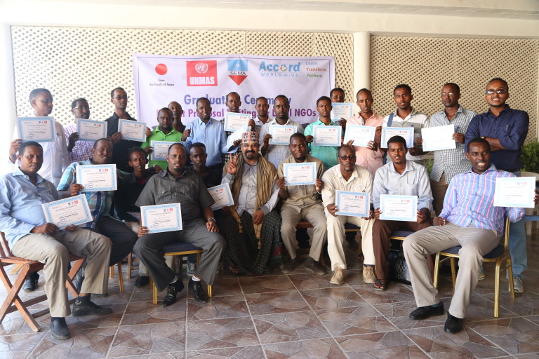 The group of participants in Somalia Proposal Writing standing with their certificates